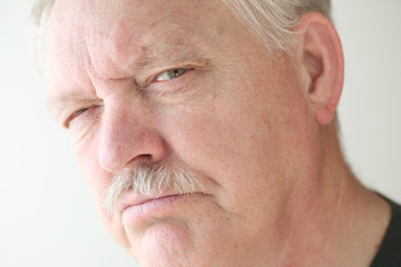 Stern and irritable senior man