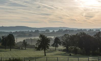 sunrise in the hills of belgium