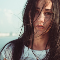 Young woman with mess black long hair portrait close up
