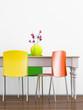canvas print picture - Esstisch mit bunten Stühlen