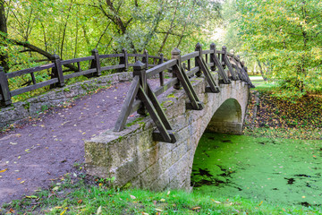 Small, beautiful bridge across the tranquil river