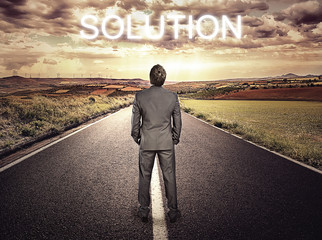 Businessman on highway. Straight path to problem solution.