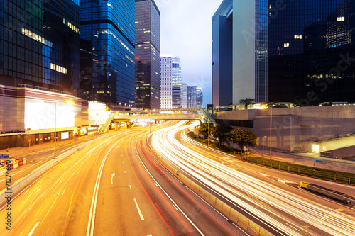 canvas print picture modern city urban traffic light trails and business buildings