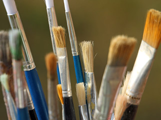 brushes used by a painter in painting workshop