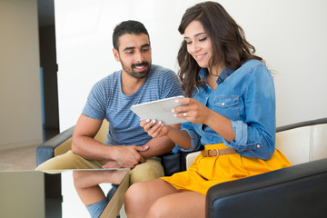Couple using tablet
