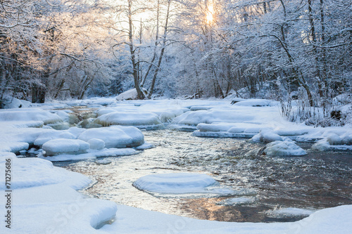 Flowing river at winter - 71275686