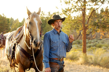 Cowboy with cigar and his horse