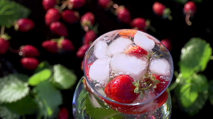 Ice Cubes Falling into Berry Drink