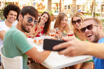 Group Of Friends Taking Selfie During Lunch Outdoors