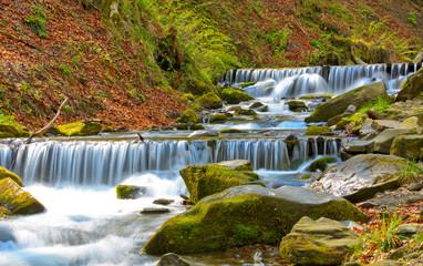 cascade on mountain river
