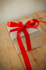Silver Gift Box with Trailing Red  Ribbon