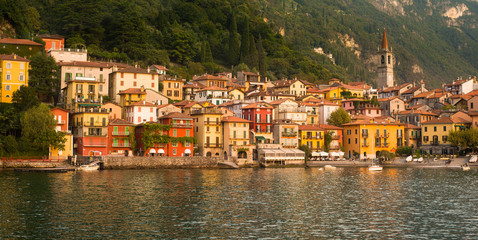 Varenna in the golden hour sunlight seen from the lake, Lake Com