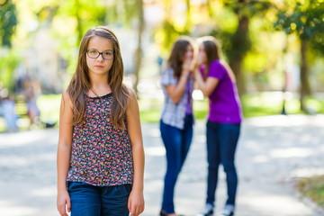 Envious girls discriminating her girlfriend