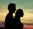 Silhouettes of the young couple
