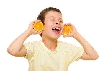 boy with sliced oranges