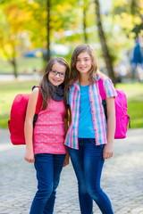 Teenage schoolgirls with schoolbag