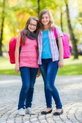 Teen friends with schoolbag