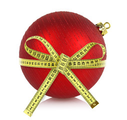 Christmas ball with measuring tape isolated on white