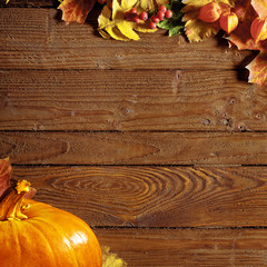 background with colored leaves on wooden board