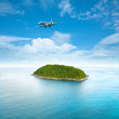 Private jet plane over the tropical island