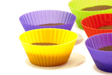 Chocolate muffins in silicone holders of many colors