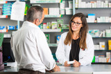 Pharmacist and Client in a Drugstore - 71281879