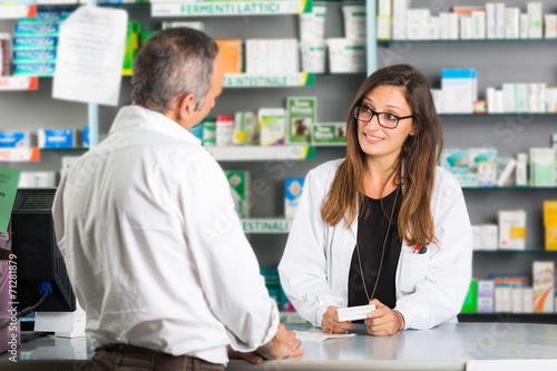 Foto op Aluminium Apotheek Pharmacist and Client in a Drugstore