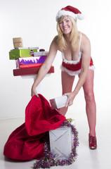 Sexy Santa sorting Christmas presents into the sack
