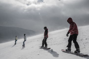 Group of snowboarders on top of the mountain
