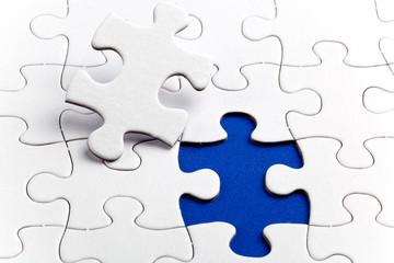 Plain white jigsaw puzzle, on Blue background