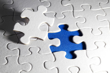 Plain white jigsaw puzzle, on Blue background