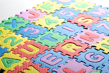 Multicolored plastic toy letters spelling the word Autism