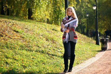 Young woman walking on a beautiful fall day