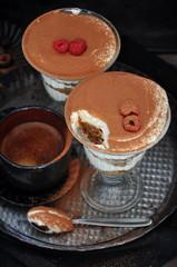 Italian dessert Tiramisu in glasses, selective focus