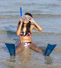 woman with snorkel sitting in the sea
