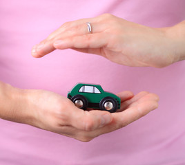 Woman hold in hand miniature car
