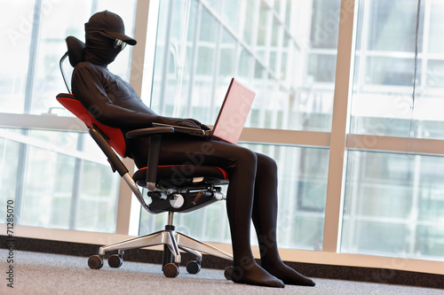 canvas print picture professional anonymous hacker working with laptop in office