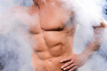 muscular bodybuilder over smoke
