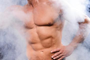 muscular bodybuilder over smoke
