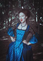 Beautiful woman vampire in medieval dress