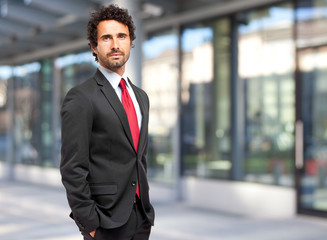 Handsome businessman against blurry background