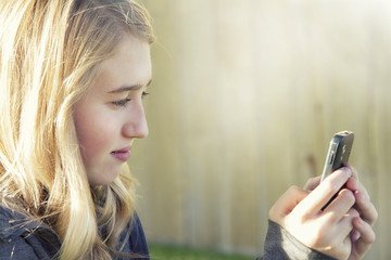 Teenage girl using a cell phone