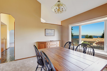 Cozy dining area with scenic window view