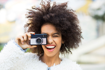 African American woman with vintage camera