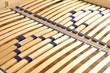 Leinwanddruck Bild - Lattenrost im Doppelbett