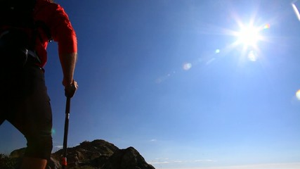 Skyrunner runs along a mountain trail.