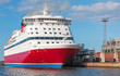canvas print picture - Red and white passenger ferry is moored in port
