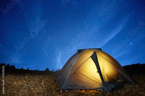 Fotobehang Kamperen Illuminated yellow camping tent