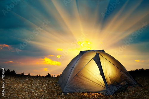 Tuinposter Kamperen Illuminated yellow camping tent