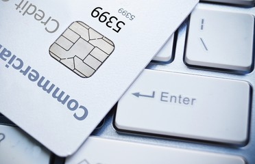 Close up shot of credit card and computer keyboard